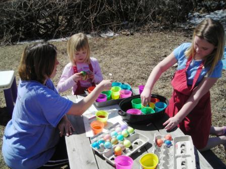 My girlies dyeing eggs this year OUTDOORS!