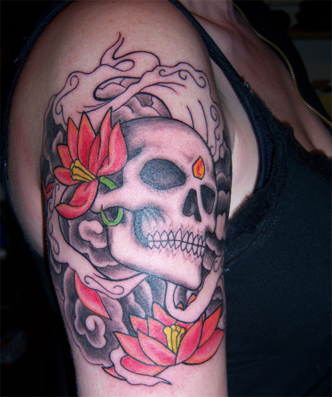 "skull tattoo with flowers. V.I.P. ""Very Illustrated People"" Tattoo Studio is business in Duluth,"