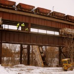 Derailed train cars fall from bridge by Duluth's ore docks