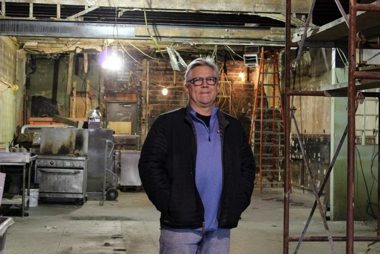 Duluth Grill owner Tom Hanson stands in the gutted 1886 structure that will house his next restaurant venture.