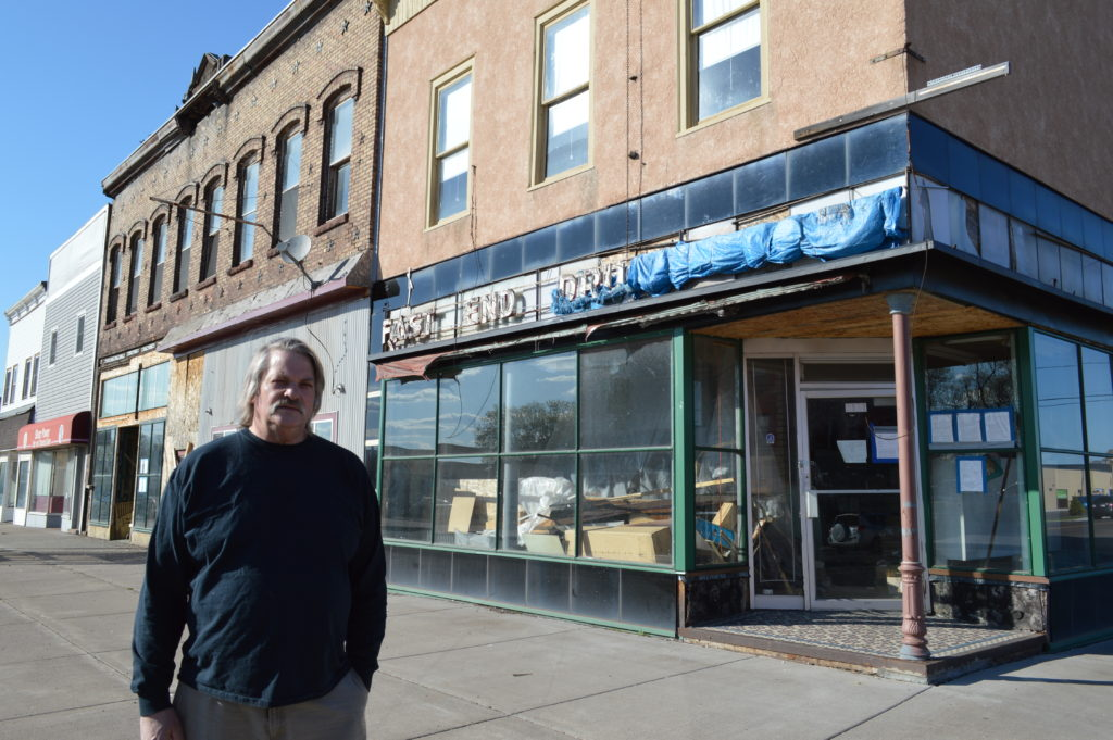 Walter Haugen stands outside the former East End Drug store his father operated for almost 70 years in Superior. The set of buildings on East Fifth Street are planned for demolition this spring.