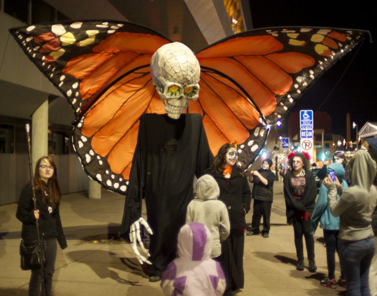 Photo by Steve Ash Foreground 10' Death papier-mâché and cloth puppet made for the first 2008 Duluth All Souls Night (DASN) with background giant Monarch butterfly made for the 2015 Duluth Children's Museum as an ARAC art project grant.