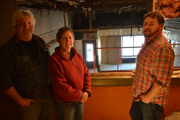 Duluth Pottery co-owners Tom Hollenhorst and Karin Kraemer pose in the loft of their new art studio with partner artist Luke Krisak. Duluth Pottery is remodeling the former P&J Paint building in the West End.