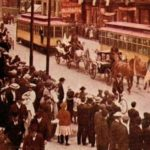 Postcard from a parade on Superior Street in 1909