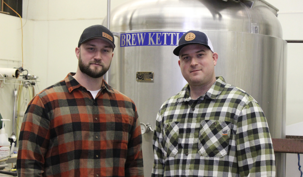 Matt Caple and Ben Gipson in front of the stainless brew kettle