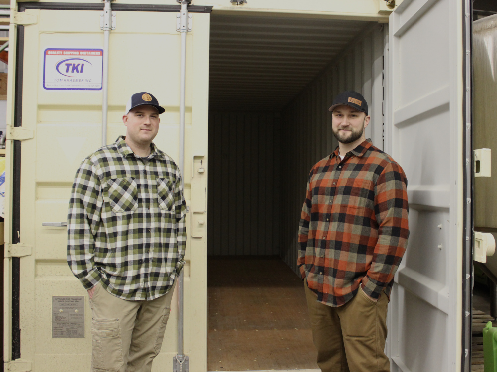 Ben Gipson and Matt Caple standing in front of a shipping container that will be turned into cold storage for the brewery
